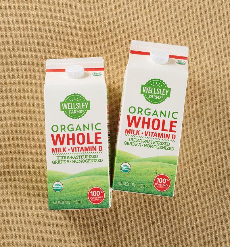 overhead photo of two cartons of Wellsley Farms organic whole milk on burlap